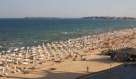 Sunny Beach, Bulgaria - August 16, 2015: Sea beach with people on a sunny morning from a hotel window DIT Blue Pearl