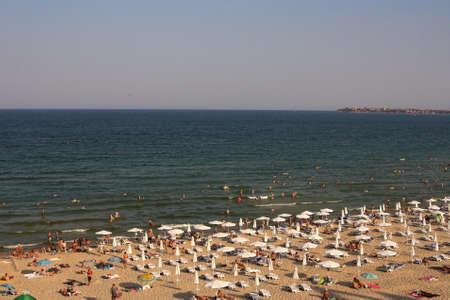 Sunny Beach, Bulgaria - August 16, 2015: Sea beach with people on a sunny morning from a hotel window