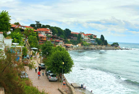 Old Nessebar, Bulgaria - August 22, 2015: Coast of the island Old Nessebar on the Black Sea with the traditional old houses and tourists