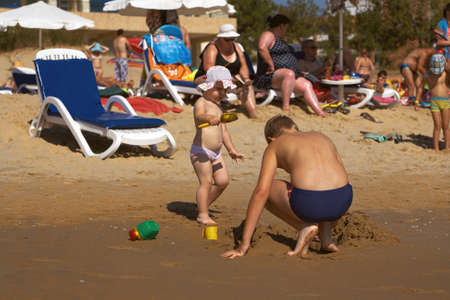 Sunny Beach, Bulgaria - August 24, 2015: Children playing with toys on the beach on the Black Sea