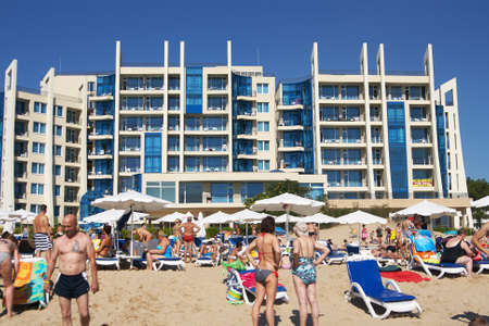 Sunny Beach, Bulgaria - August 06, 2015: View from the sea on the beach sunbathing people and hotel DIT Blue Pearl in the Bulgarian resort of Sunny Beach