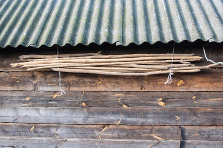 Old wall texture with a roof hanging the wood cuttings