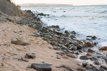 Sandy beach with stones in the sea Banque d'images - 126054445