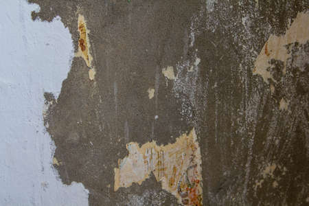 Old torn and scratched concrete wall