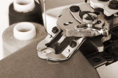 sew buttons on a machine, clothes, clothing; photo