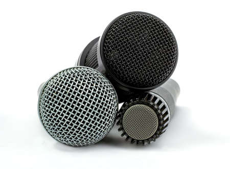 one condenser microphone and two dynamic microphones, isolated on white background