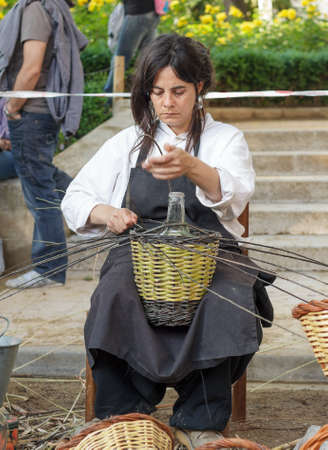A woman showing the craft of basket-making Editorial