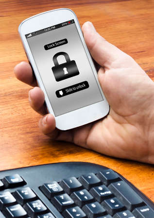 A man holding phone on the table with a lock screen message
