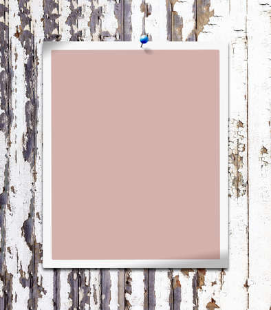 Empty photo frame with blank edge and wood background - to place an image