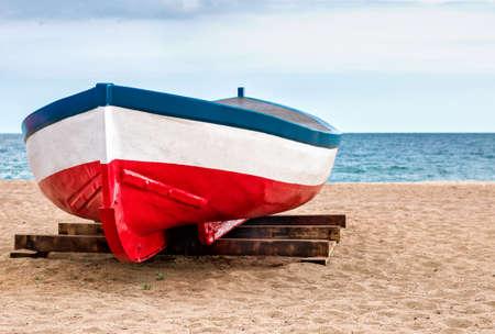 Fisher boat at sand Banco de Imagens