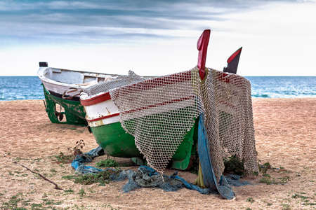 Abandoned fishing boats on the beach
