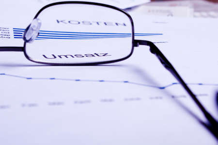 different business documents, viewed trough some glasses Stock Photo - 17471569