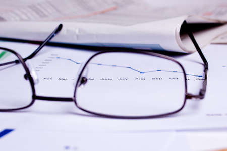 different business documents, viewed trough some glasses Stock Photo - 17467063