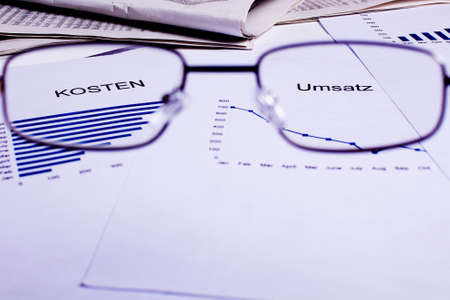 different business documents, viewed trough some glasses photo
