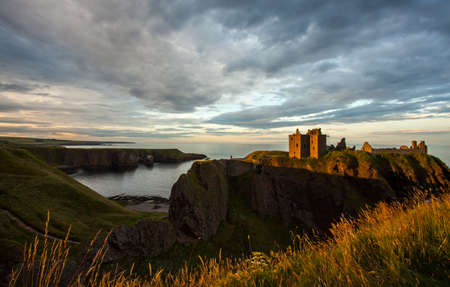 Dunnottar Castle and moody sunset