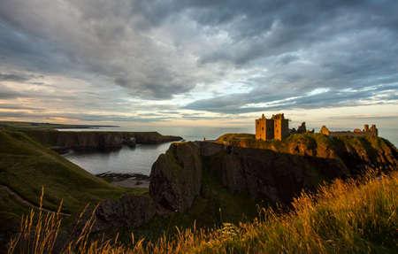 dunnottar castle: Dunnottar Castle and moody sunset