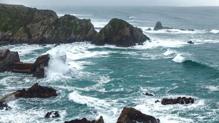 unstoppable: wild Atlantic storm waves breaking on rocky coast