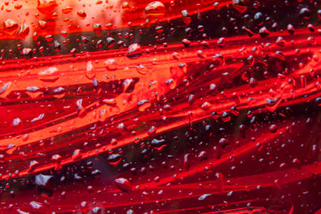 Red glass stripes design Background with water drops Stock Photo