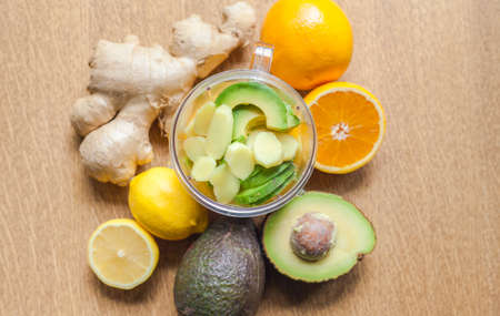 ginger-avocado shot homemade healthy Power- Drink ingredients top view Stock Photo