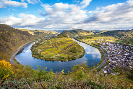 Calmont Moselle loop Landscape in golden autumn colors and the village Bremm Travel Germany
