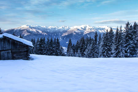 South tirol snow  mountains landscape and wooden cabin winter travel