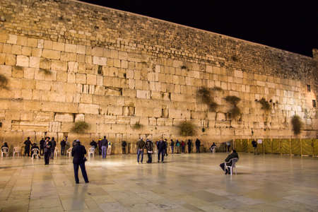 praying people at the western wall in the evening Jerusalem religion travel israel