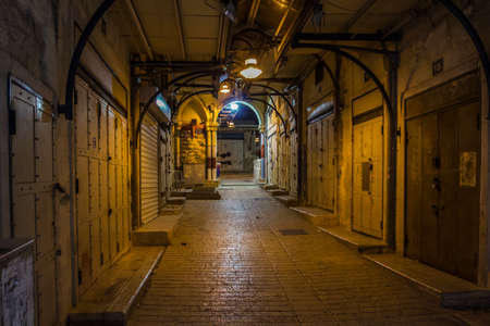 Empty market alley in Nazareth at night Israel