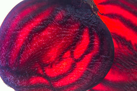 fresh red beet slices translucent food macro on lighted background