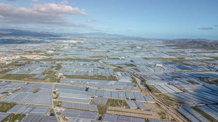 Drone aerial view of the greenhouses in the region of Andalusia Mar del Plastico or Europe's plastic garden