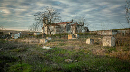 Abandoned church ruin and cemetery overgrown landscape Lost Places 写真素材 - 143198430