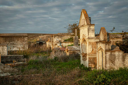 Abandoned  ruin  cemetery  and overgrown landscape  Nature Lost Places 写真素材 - 143198442