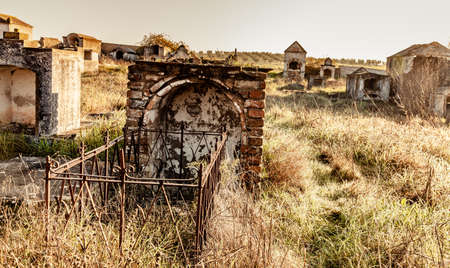 Abandoned  ruin  cemetery  and overgrown landscape  Nature Lost Places 版權商用圖片