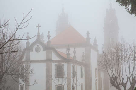 Church Sanctuary of Nossa Senhora dos Rem?dios in the morning mist Lamego Portugal Standard-Bild