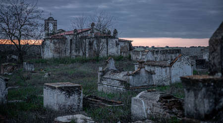 Abandoned church ruin and cemetery overgrown landscape Nature Lost Places 版權商用圖片
