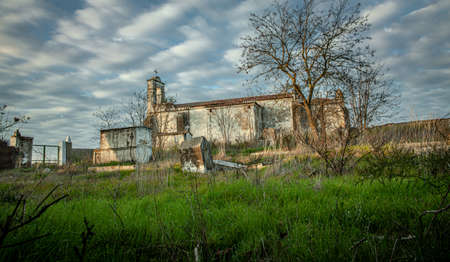 Abandoned church ruin and cemetery overgrown landscape Lost Places 写真素材 - 143198874