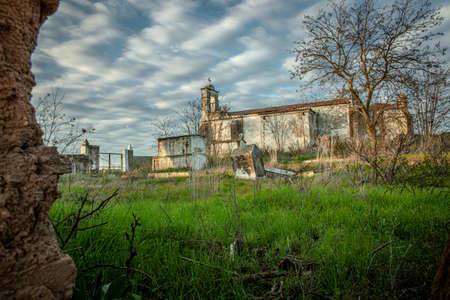 Abandoned church ruin and cemetery overgrown landscape Lost Places 写真素材 - 143198733