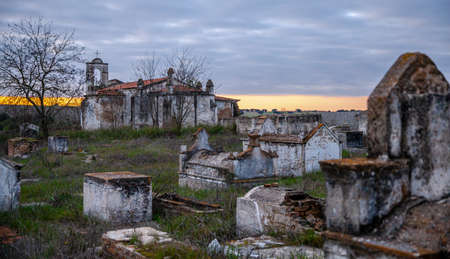 Abandoned church ruin and cemetery overgrown landscape Nature Lost Places 写真素材