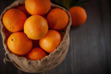 Oranges in sackcloth basket citrus fruit food vitamins