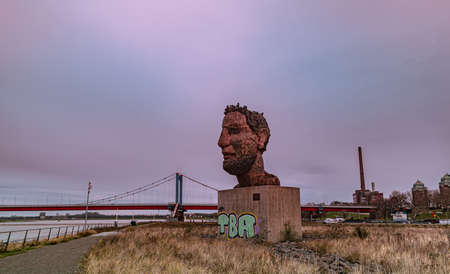 Bronze statue by the sculptor Markus Luepertz  Echo des Poseidon at the port of Duisburg Germany Editorial