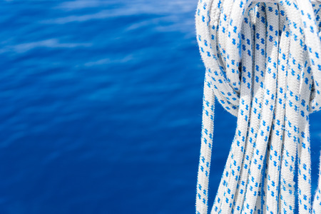 Sailing Fall Ropes on Blue Sea Background