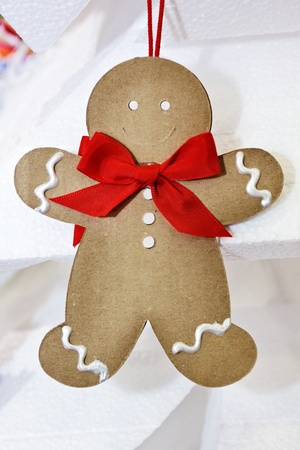 Little paper puppet made as christmas decoration, smiling for christmas Stock Photo