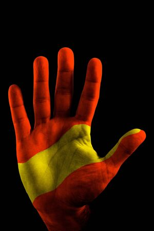 A opened Hand with the Spain Flag painted on it, like saying STOP.