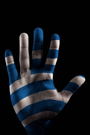 A opened Hand with the Greece Flag painted on it, like saying STOP Crisis  Stock Photo
