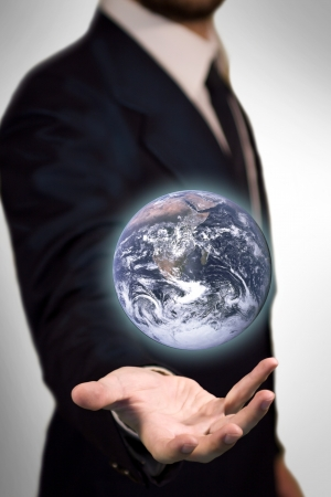 Earth Sphere in the palm of a business man like a magic sphere