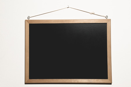 A plain black blackboard, ready to be filled of text and words to start the lesson