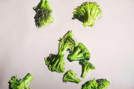 brocolli: Freeze Dropping Green Brocolli on White Background Stock Photo