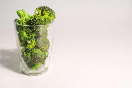 brocolli: Green Brocolli in Transparant Glass on White Background