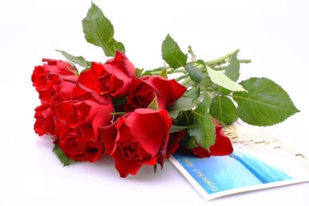A bunch of roses on a holiday postcard  Stock Photo - 15607504