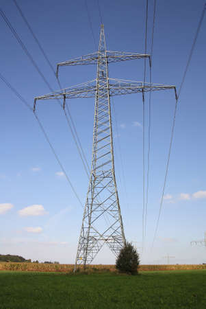 Electricity pylon with white clouds 스톡 콘텐츠