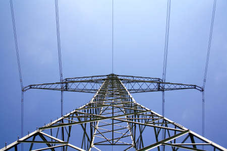 Electric pylon with the wires in front of blue sky photo